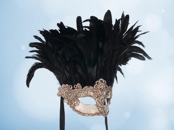 Zilveren balmasker met zwarte veren